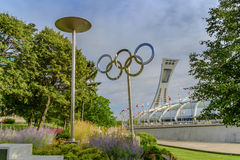 The Olympic rings and stadium. The Olympic Stadium[7] (French: Stade olympique) is a multi-purpose stadium in Canada, located at Olympic Park in the Hochelaga Stock Images