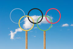 Olympic rings stand under bright blue sky iin a golf course Royalty Free Stock Photography