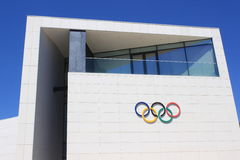 Olympic Rings Symbol. On Romanian Olympic Committee and sports Museum in Bucharest city,Romania Stock Photos