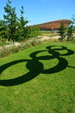Olympic rings symbol shadow and velodrome Stock Images