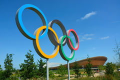 Olympic rings symbol and velodrome. The Olympic rings with the London 2012 iconic velodrome in the background Stock Photography