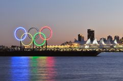 Olympic rings in vancouver harbour. Olympic rings on the barge, viewed from Stanley Park Stock Photography