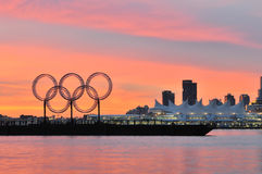 Olympic rings in vancouver harbour. Olympic rings on the barge, viewed from Stanley Park Stock Photos