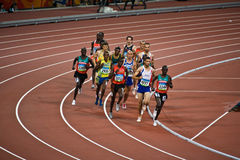 Olympic Runners. Athletes competing in Men's 3000m Steeplechase race inside the Bird's Nest stadium during the Beijing Olympics