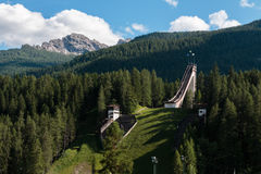 Olympic Ski Jumping Trampoline in Summer Time. Abandoned Olympic Ski Jumping Trampoline among Mountains Scenery in Summer Time Stock Photos