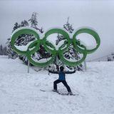 Olympic skier. A photo of a skier next to Olympic Rings Royalty Free Stock Photos