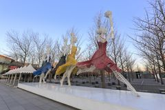Olympic sport statues in beijing at sunrise, adobe rgb. Olympic sport statue hold torch light and run in beijing olympic park in winter Royalty Free Stock Image