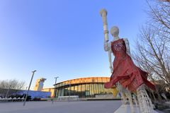 Olympic sport statues out of china national stadium, adobe rgb. Olympic sport statue hold torch light and run in beijing olympic park in winter Royalty Free Stock Photo
