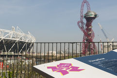 Olympic Stadium. LONDON, UK – MARCH 24: Details of information board with London Olympics logo and Stadium and sculpture in the background on March 24, 2012 in Royalty Free Stock Images