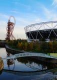 East London, UK: Olympic Stadium and Arcelormittal Orbit, Stratford. Olympic Stadium and Arcelormittal Orbit reflected in canal, Stratford, London. October 2015 Stock Photos