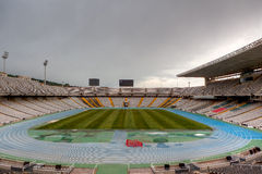 Olympic Stadium, Barcelona, Spain. Empty olympic track and field stadium Barcelona, Spain 1992, under the clouds Royalty Free Stock Images