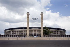 Olympic Stadium Berlin Exterior Main Entrance View. View of the Olympic Stadium in Berlin, with main entrance and Olympic Rings, against cloudy sky Royalty Free Stock Photos