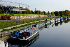 East London, UK: Olympic Stadium and canal with canal boats, Hackney Wick, Stratford. Royalty Free Stock Photos