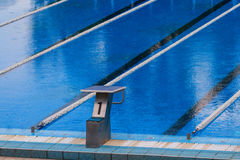 Olympic swimming pool. Empty olympic swimming pool with clear blue water Royalty Free Stock Photo