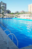 Olympic swimming pool. Sunny day at the club. Summer Stock Images