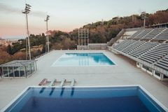 Olympic swimming pools in Barcelona at sunset royalty free stock image