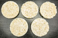 Olympic symbol formed of rice cakes. Olympic symbol created from rice cookies on a wooden background Stock Photo