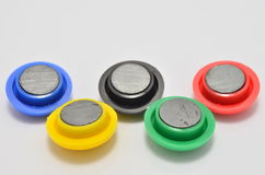 Olympic Symbol Magnets. Magnets laid out as the Olympic Rings Stock Images
