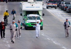 Olympic Torch. Bearer Beena Goldenberg runing on Burnhamthorpe Street on the first leg of the Mississauga Torch relay Stock Image