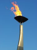 Olympic torch. Remembering Barcelona'92 anniversary. Close up of the flame over a blue sky royalty free stock photo