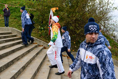 Olympic torch bearer. SVETLOGORSK, RUSSIA - OCTOBER 29: Olympic torch bearer participates in relay of Olympic Flame on October 29, 2013 in Svetlogorsk, Russia Royalty Free Stock Photography