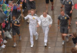 Olympic torch blind runner Royalty Free Stock Photo