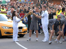 Olympic torch kiss Stock Photos