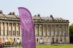 Olympic torch relay 2012,Bath, UK. Bath, UK - May 22, 2012: A London 2012 Olympic banner in Bath's Royal Crescent before the arrival of the 2012 Olympic Torch Stock Image