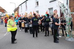 Olympic Torch Relay, Rye. The Blocco Drummers of Rye College perform at the Olympic Torch Relay event at Rye in East Sussex, England on July 18, 2012. The torch Royalty Free Stock Photos
