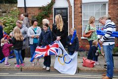 Olympic Torch Relay, Rye. People line the streets at the Olympic Torch Relay event at Rye in East Sussex, England on July 18, 2012. The torch made a 70 day tour Stock Image