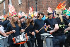 Olympic Torch Relay, Rye. The Blocco Drummers of Rye College perform at the Olympic Torch Relay event at Rye in East Sussex, England on July 18, 2012. The torch Stock Photos