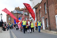 Olympic Torch Relay, Rye. Rex Swain, Town Crier, leads the parade through the streets during the Olympic Torch Relay event at Rye in East Sussex, England on July Stock Photos