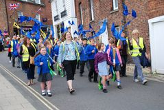 Olympic Torch Relay, Rye. Children parade through the streets during the Olympic Torch Relay event at Rye in East Sussex, England on July 18, 2012. The torch Royalty Free Stock Photography