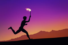 Olympic torch runner. Illustration of an olympic torch runner outlined at dawn on mountains skyline background Royalty Free Stock Photo