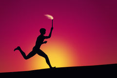 Olympic torch runner. Illustration of an olympic torch runner outlined at dawn Stock Photo