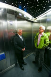 Olympic Tower Munich. MUNICH, GERMANY - MAY 6, 2017 : Two men in an elevator of the 291 m high Olympic Tower in the Olympic Park in Munich, Germany Stock Image
