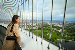 Olympic Tower Munich. MUNICH, GERMANY - MAY 6, 2017 : A woman looking at the cityscape at the observation platform of the Olympic Tower in the Olympic Park in Stock Image