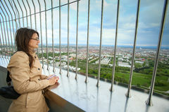 Olympic Tower Munich. MUNICH, GERMANY - MAY 6, 2017 : A woman looking at the cityscape at the observation platform of the Olympic Tower in the Olympic Park in Royalty Free Stock Photography