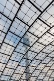 Olympic tower in munich shot through famous woven glass roof con. Tall olympic tower in munich shot through famous woven glass roof contruction during cloudy Royalty Free Stock Images