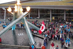 2010 Olympic Winter Games cauldron. And Canadian flag during anniversary of Vancouver Games at Jack Poole Plaza Royalty Free Stock Photography