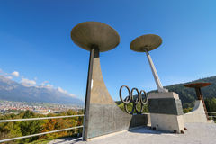 Olympic Winter Games rings and torches, Austria. The Olympic Winter Games rings and torches located on Bergisel hill in Innsbruck, Austria on September 23, 2014 Royalty Free Stock Photos
