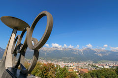 Olympic Winter Games rings and torches, Austria. The Olympic Winter Games rings and torches located on Bergisel hill in Innsbruck, Austria on September 23, 2014 Royalty Free Stock Image