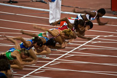Olympic women's runners. Start of Womens 100M sprint. Athletes take off as the women's 100M sprint begins at the Beijing Olympics