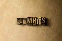 OLYMPICS - close-up vintage sujo da palavra typeset no contexto do metal Imagens de Stock