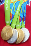 Olympics gold and silver medals won by swimmer Simone Manuel presented during Arthur Ashe Kids Day 2016. NEW YORK - AUGUST 27, 2016: Rio 2016 Olympics gold and royalty free stock image