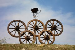 Olympics logo made of cart wheels. The Olympics logo at a transylvanian village harvest competion made of cart wheels Royalty Free Stock Photography