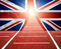 Olympics London. Concept with sun shining trough flag curtains on running track Royalty Free Stock Photography