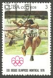 Olympics Montreal, Long jump. Cuba - stamp printed 1976, Multicolor issue, Topic Sport and Olympic Games,  Series 1976 Summer Olympics Montreal, Long jump Stock Photo