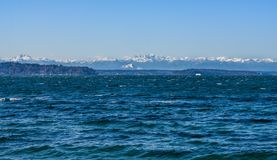 Olympics From Seahurst Beach 10. A view of the Olympic Mountains from Seahurst Beach Park in Burien, Washington stock photo