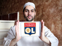 Olympique Lyon, Olympique Lyonnais, football club logo. Logo of french football club  Olympique Lyon, Olympique Lyonnais, on samsung tablet holded by arab muslim Stock Photo